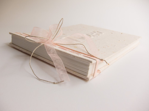 Hardcover wedding book with handmade paper and emboss